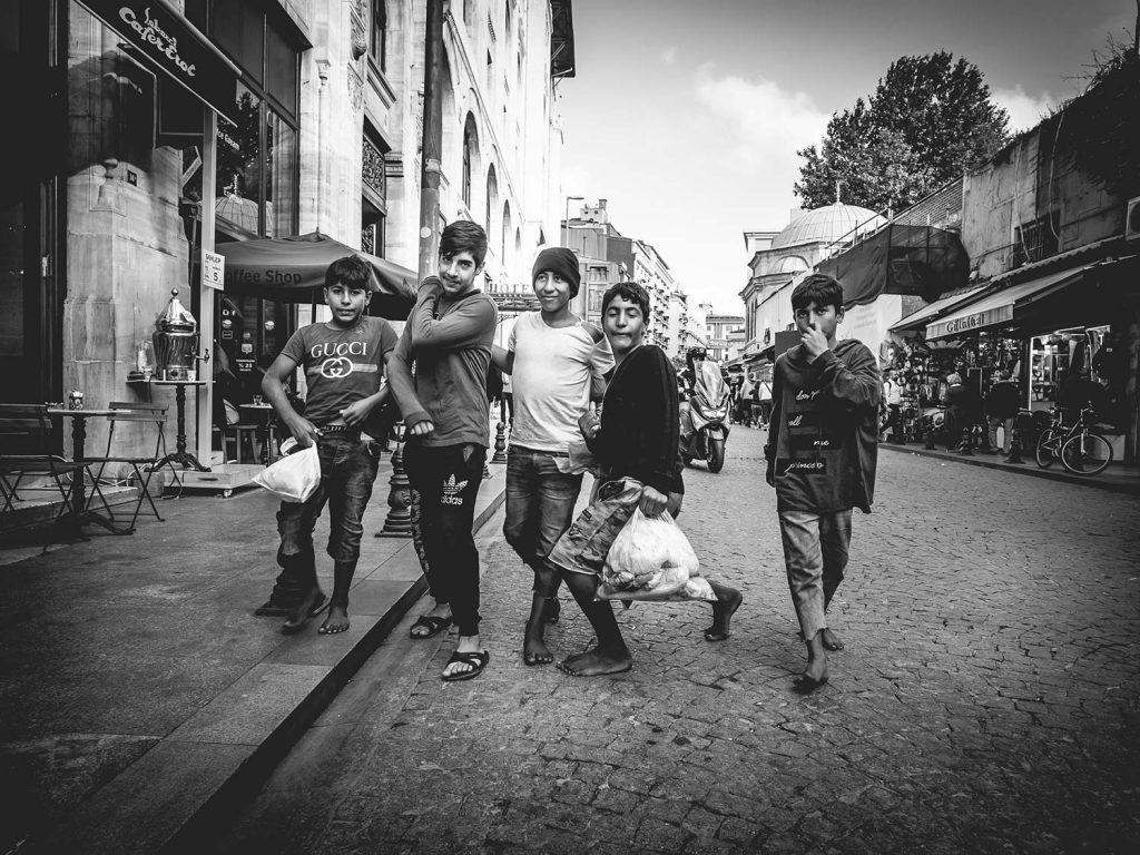 Homeless Kids posing on the street.