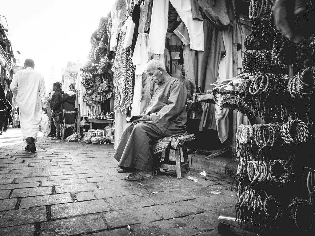 Old man sitting in front of his shop and reading. This pic was taken in Cairo with the zone focussing technique.