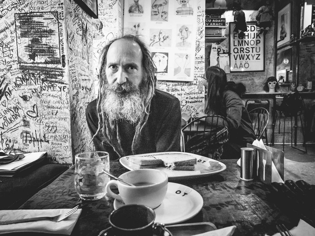 Man sits in a cafe.